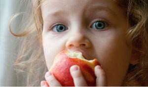 o-KID-EATING-APPLE-facebook